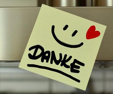 """Post-it Notizzettel mit Smiley, rotem Herz und dem Wort """"Danke"""""""